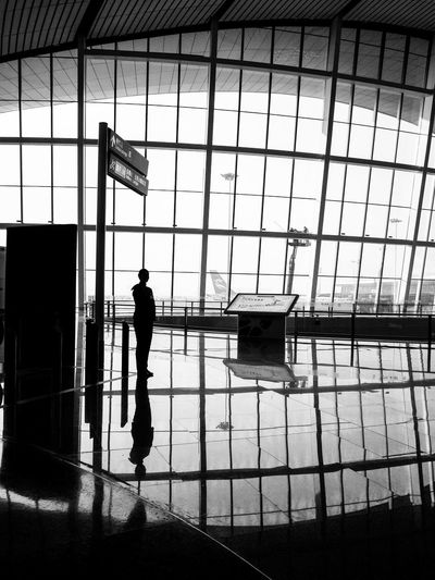 Silhouette man walking in airport