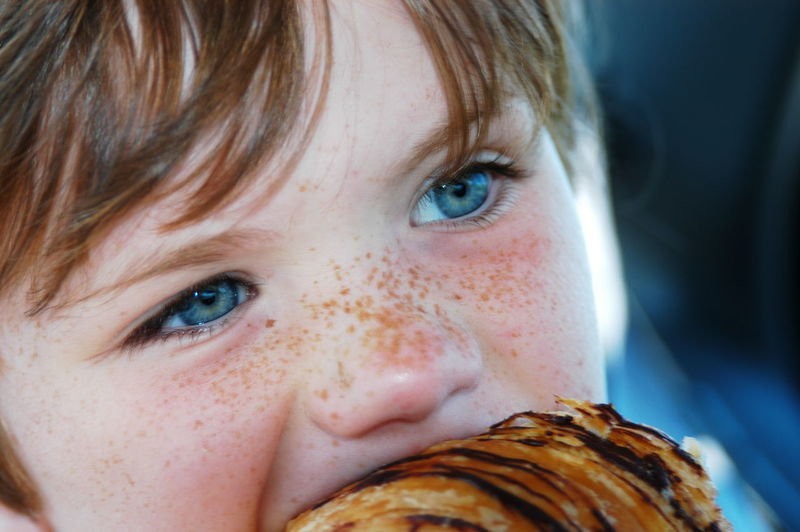 Close-up of cute boy eating food