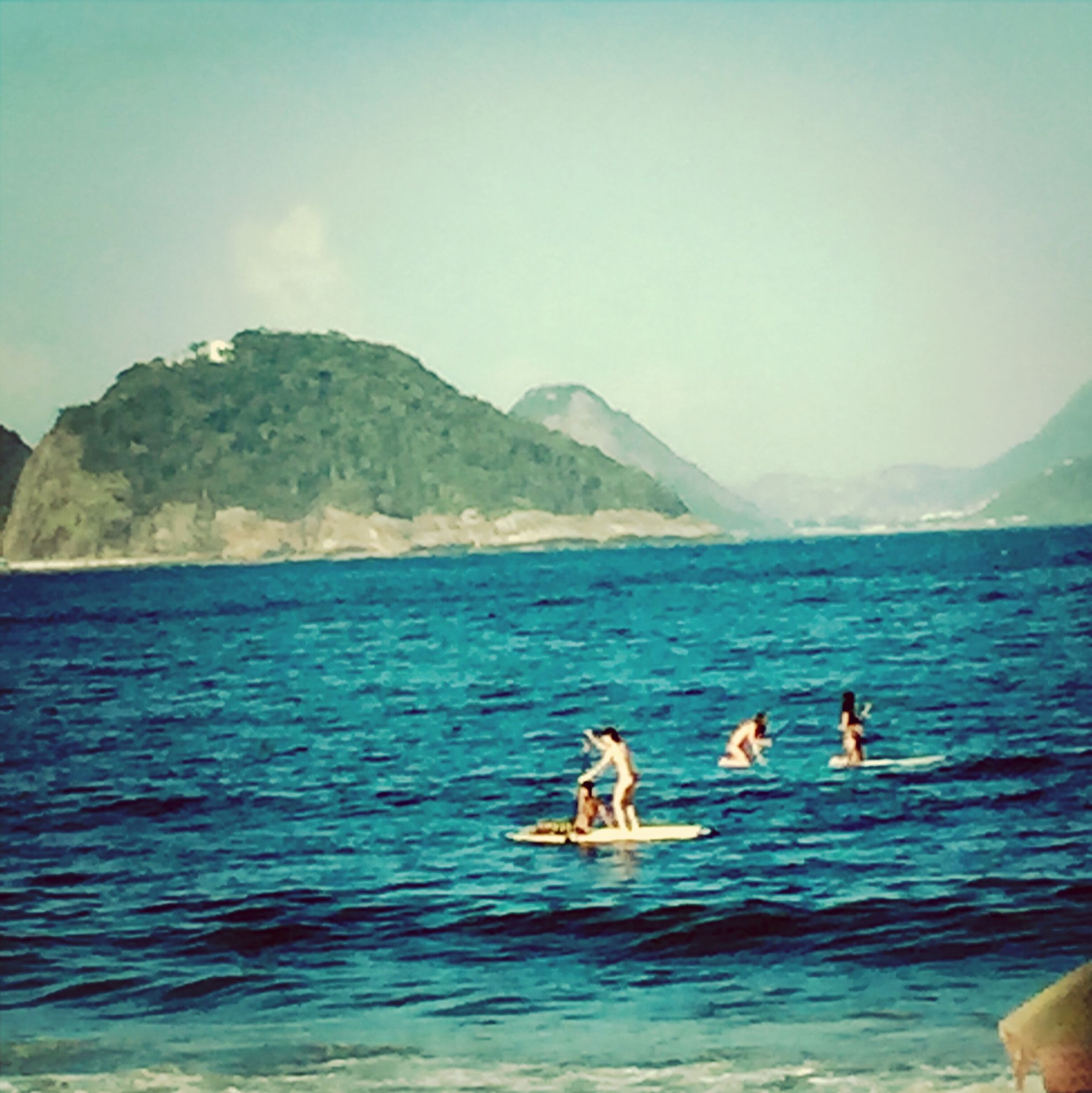 water, sea, swimming, animal themes, waterfront, leisure activity, blue, vacations, lifestyles, mountain, men, nature, beauty in nature, scenics, pets, sky, domestic animals, dog, mammal