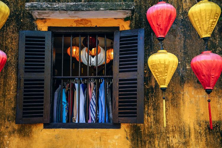 Illuminated lanterns hanging on clothesline