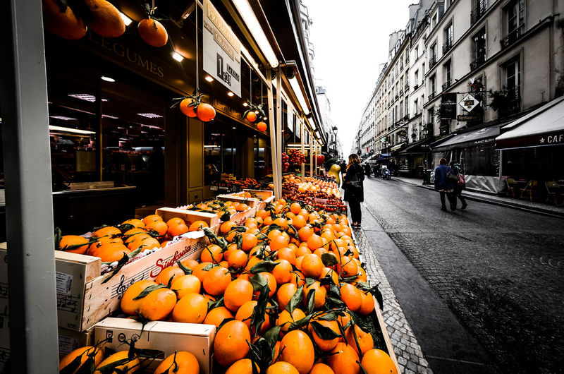 Orange fruits on street at market stall