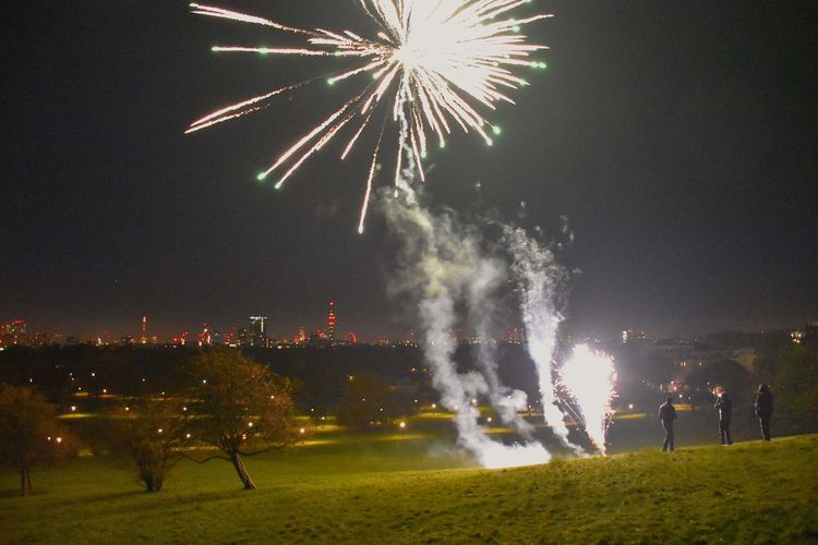Cityscape Primrose Hill London Architecture Arts Culture And Entertainment Bonfire Night Building Exterior Celebration Event Exploding Firework Firework Display Illuminated Leisure Activity Motion New Year Eve Night Outdoors People Real People Responsibility Sky Smoke - Physical Structure Three People Young Adult Young Men