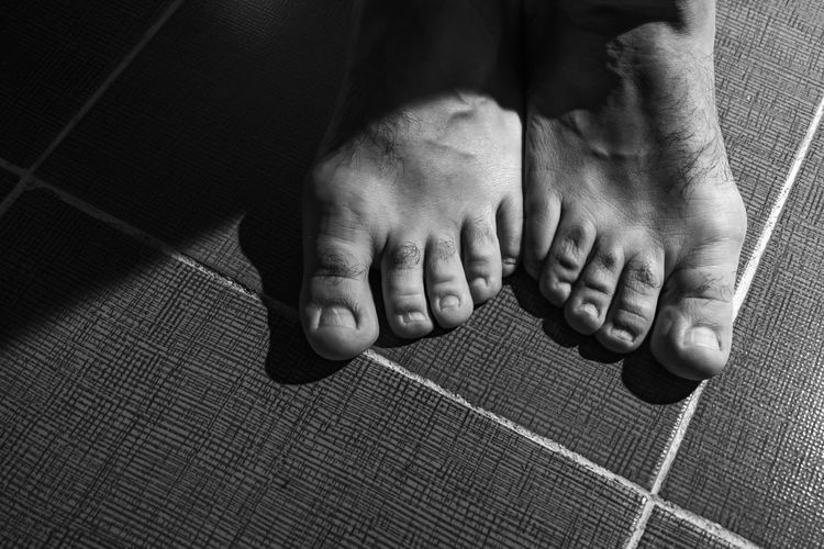 Low section of man with foots