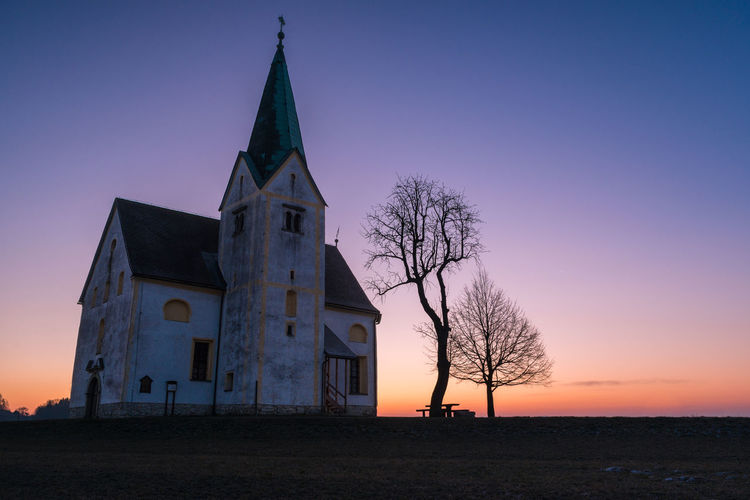 Abandoned church at sunrise Abandoned Architecture Bell Building Church Cold Colorful Colors Dawn Exterior Landscape Old Photography Slovenia Sunrise Tower Trees Winter