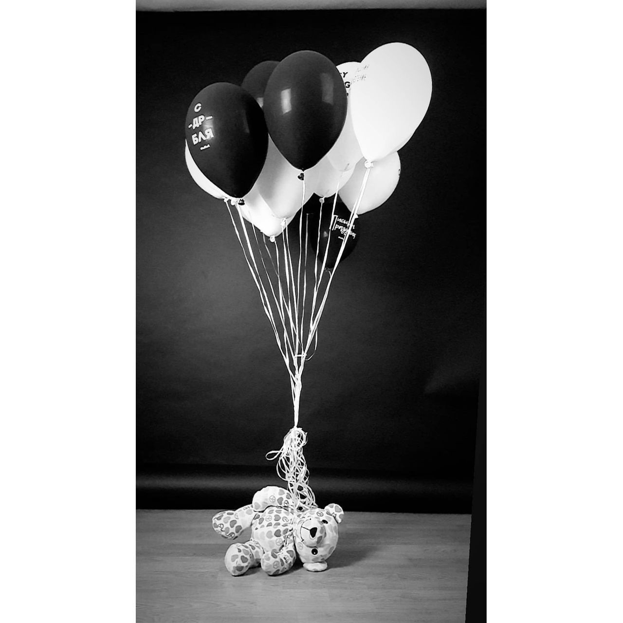 CLOSE-UP OF BALLOONS IN GLASS ON TABLE