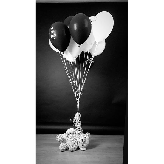 Close-up of balloons on table against white background