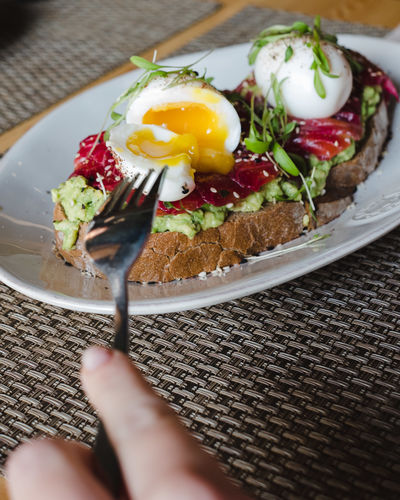 Food Food And Drink Healthy Eating Ready-to-eat Freshness Egg Wellbeing Indoors  Vegetable Meal Breakfast Table Serving Size Fruit Plate Human Hand Fried Egg High Angle View Close-up Human Body Part Hand Garnish Temptation