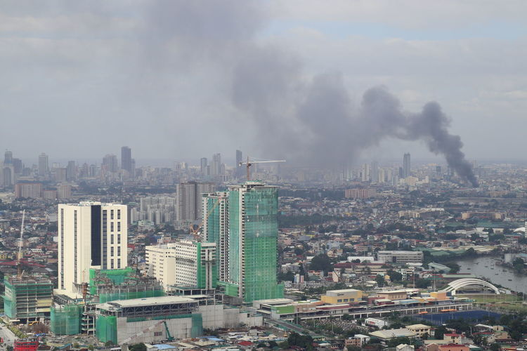 Manila cityscape filled with smoke Burning Manila Manila, Philippines Philippines Architecture Building Exterior Built Structure City Cityscape Crowded Day Desaster Developing Country Environmental Damage Fire Nature Outdoors Sky Skyscraper Smoke - Physical Structure Urban Skyline