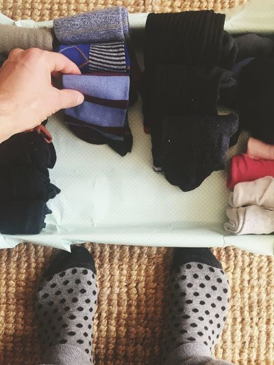 Personal perspective of person folding socks