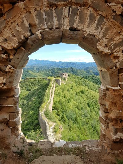 Hiking along a wild section of The Great Wall of China History Built Structure Architecture Scenics Mountain The Past Tourism Arch Tranquil Scene Beauty In Nature Tranquility Travel Destinations Nature Stone Material Sky Green Color Ruined Travel Check This Out Day World Heritage Culturethegreatwal Famous Place Thegreatwall Thegreatwalllofchina