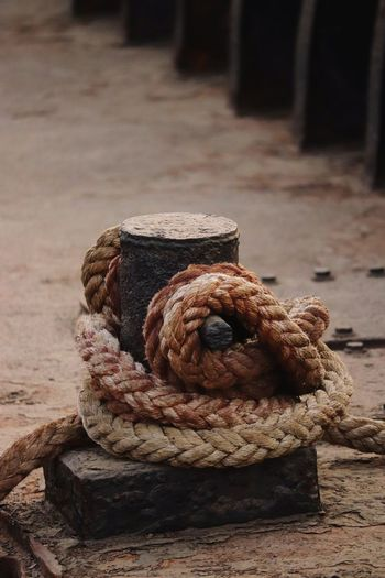 Close-up of rope tied on bollard