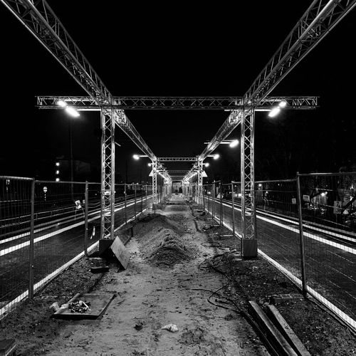 Trainstation Trussing Trainstation Truss High Contrast Dark Black And White Perspective Lines Portal Night Illuminated Connection The Way Forward Direction Diminishing Perspective No People Outdoors Railing City Metal Symmetry