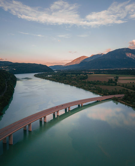 Aerial view of bridge over river against sky