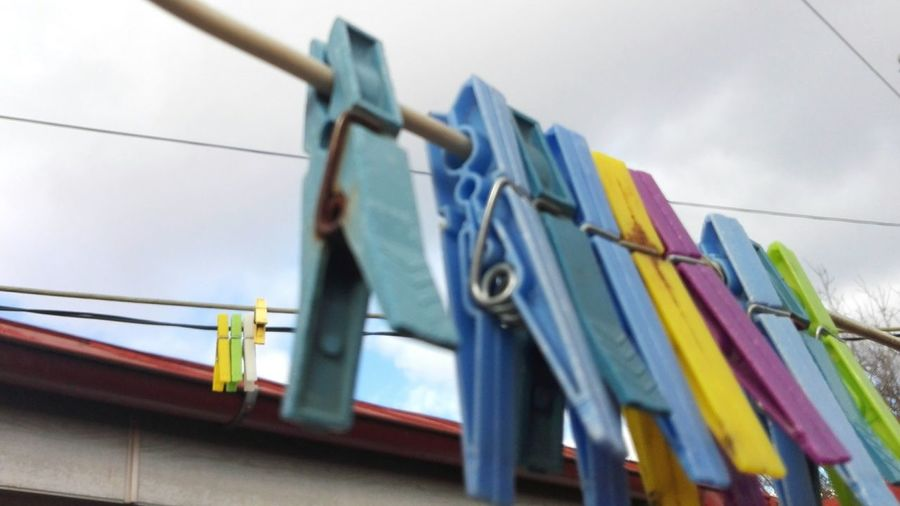 Hanging Sky Low Angle View Outdoors Multi Colored Clothesline Day No People Chores Clothespin On Market Veronicaionita Showcase: 2017 Clothespins @WOLFZUACHiV Huaweiphotography Eyeem Market Showcase: February Wolfzuachiv EyeEmNewHere Edited By @wolfzuachis Multi Colours Multi Coloured Clothespin Hanging Outside EyeEm Diversity Resist