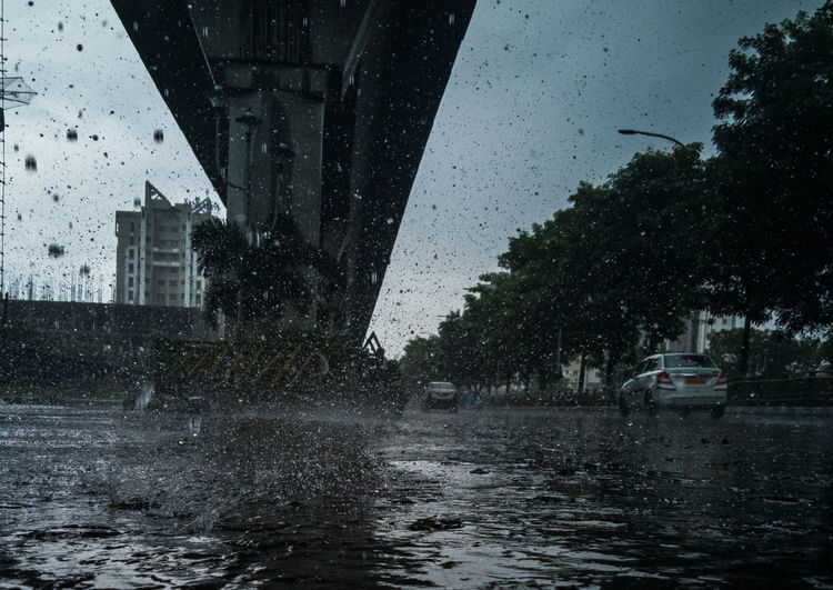 Water splashing on street in city during rainy season