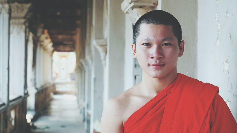 Portrait Of Monk Standing In Temple