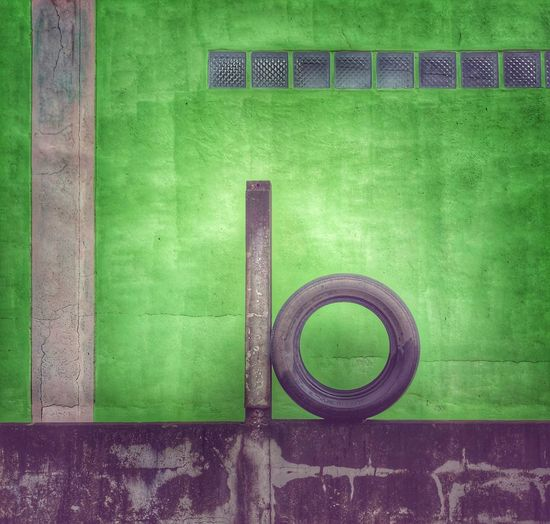 Wheel on the wall Wheel Green Color No People Grass Day Wall - Building Feature Built Structure 10 Number