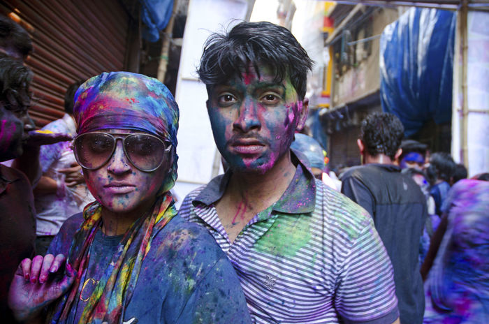 The Portraitist - 2015 EyeEm Awards Wrong Place, Wrong Time in Dhaka, Bangladesh during Holi . The Face Covered With Paint this Couple seamed Scared Celebrating Love! Traveling