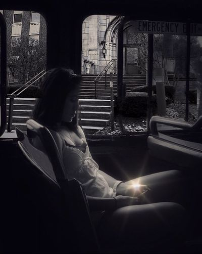 Embrace Urban Life Sitting Window One Person Real People Lifestyles Indoors  Day Women Adult City Bus Downtown Looking Down Light Reflection The Week On Eyem Exceptional Photographs Black & White Blackandwhite Photography Eyeam_bestshot EyeEm Masterclass Fine Art Photography Traveling Home For The Holidays Women Around The World Long Goodbye Welcome To Black The Portraitist