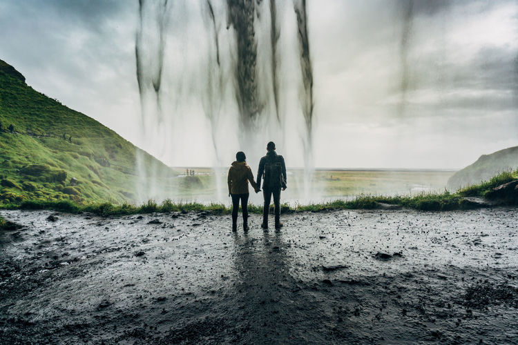 Couple Iceland In Front Of Silhouette Solitude Travelling Travlr Waterfall