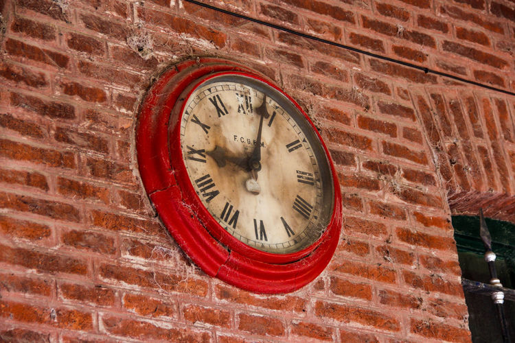 Low angle view of wall clock