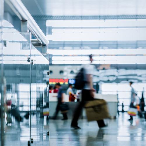 Defocused image of people walking at airport