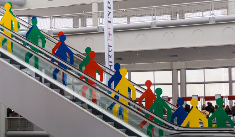 At Frankfurt Exhibition Center Arrangement City Life Escalator Exhibition Urban Scenes In A Row Indoor Multi Colored Side By Side Symbol