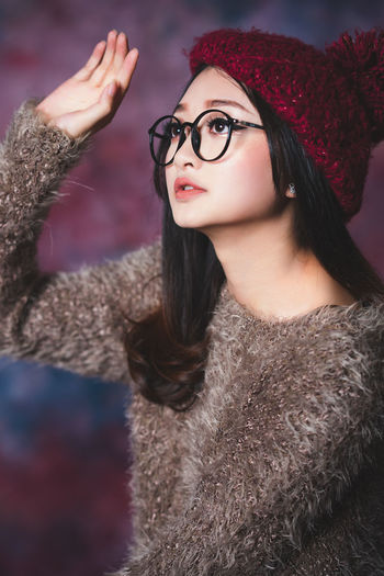 Beautiful woman looking away while wearing hat