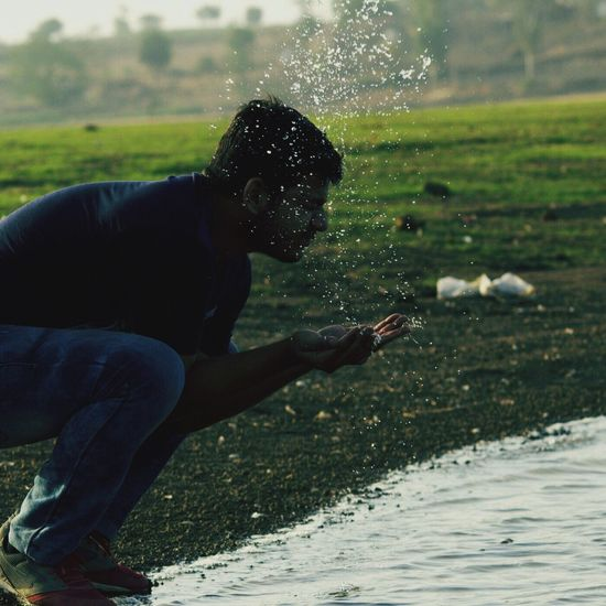 Grass Real People Water One Person Lifestyles Day Outdoors Leisure Activity Full Length Men Nature Beauty In Nature Sky Young Adult Candid Candid Photography Candidshot Canon700D