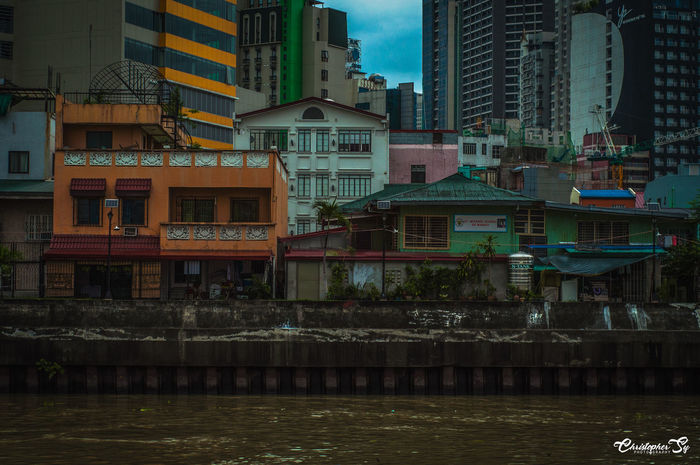 Rainbow Houses. Architecture Bike And Shoot Bike Ride Building Exterior Built Structure Christopher Sy Photography Dirty River Gloomy Day Houses Landscape Mandaluyong City Nikkor 50mm Nikon D90 No People Outdoor Photography Outdoors Philippines Residential Building River Streetphotography Water Waterfront