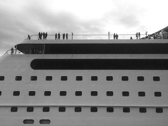 Low angle view of people on cruise ship against sky