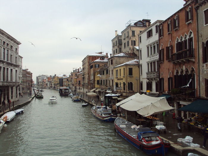 View of canal amidst buildings in city