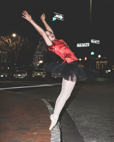 Ballet Dancer In City At Night