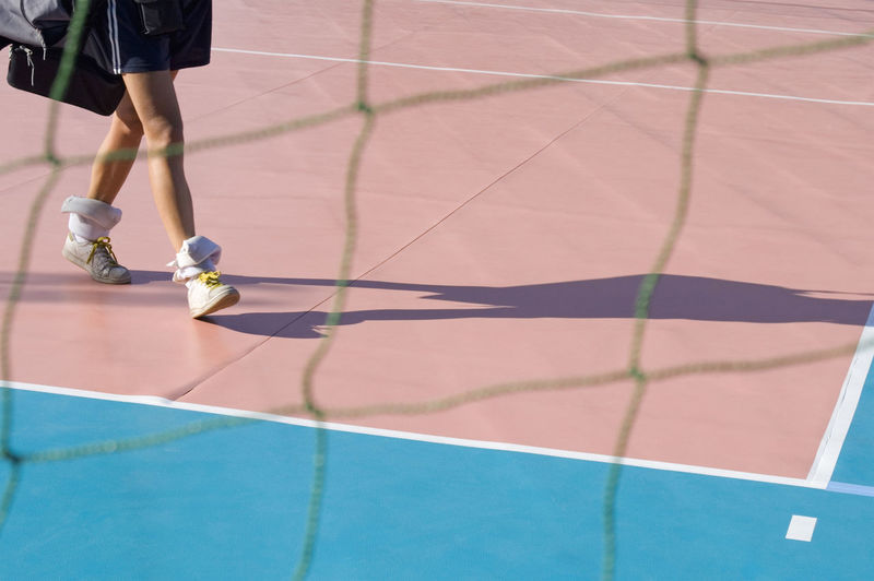 Low section of woman on tennis court