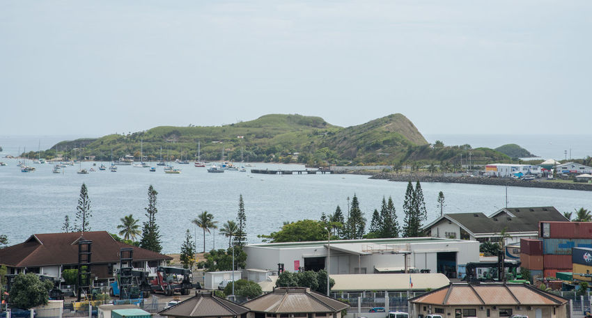 NOUMEA,NEW CALEDONIA-NOVEMBER 25,2016: Waterfront architecture, sailboats, lush island view and Pacific Ocean in Noumea, New Caledonia. Marina Noumea Transportation Architecture Beauty In Nature Boat City Clear Sky Day High Angle View Island Mountain Nature Nautical Vessel New Caledonia Outdoors Pacific Ocean Peninsula Roof Sailboat Scenics Sea Sky Town Water