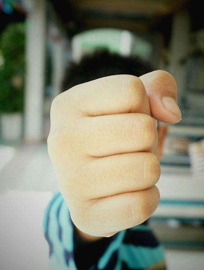 Close-up of boy punching