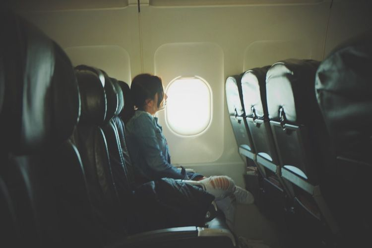 Airplane Casual Clothing Real People Airplane Seat Journey Sitting Transportation Vehicle Interior Vehicle Seat One Person Travel Mode Of Transport Indoors  Window Air Vehicle Flying Day Men Sky Adult