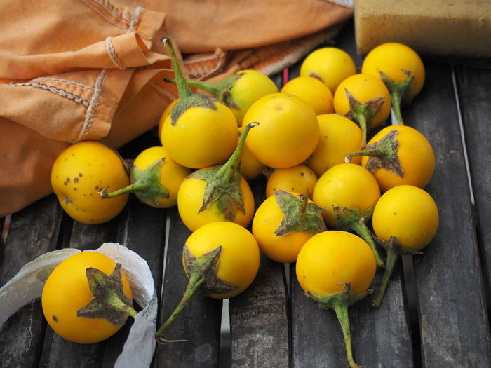 Close-up of yellow tomatoes on wooden table