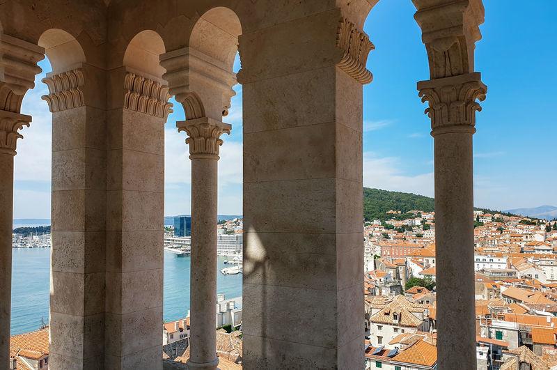 Buildings seen through colonnade