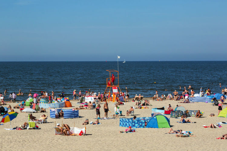 Baltic Sea Beach Crowd Group Of People Holiday Horizon Horizon Over Water Land Large Group Of People Leisure Activity Lifestyles Nature Real People Sand Sea Sky Trip Vacations Water
