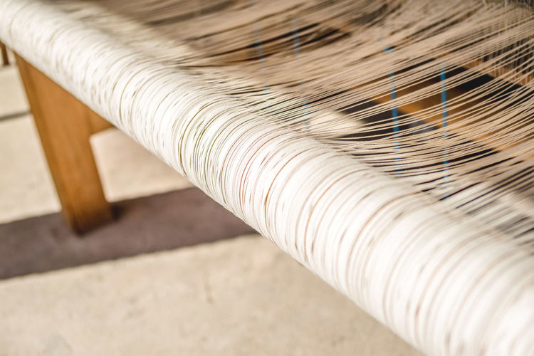 Close-Up Of Loom In Machine