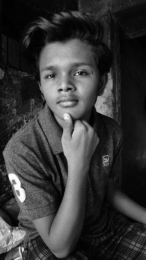 Portrait of boy sitting