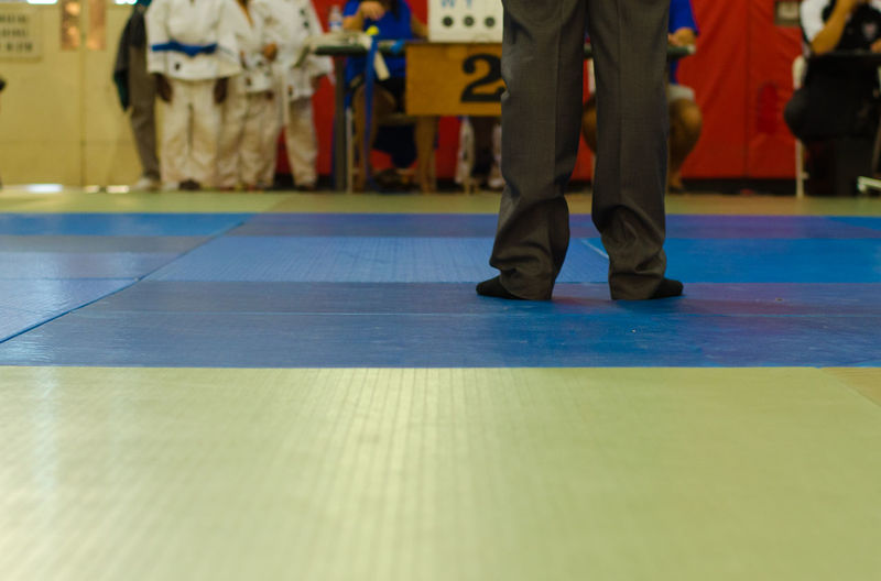 Adult Competition Human Leg Indoors  Jiu Jitsu Judo Judoka Karate Lifestyles Low Section Martial Arts Martial Arts Children Men People Real People Referee Sport Standing