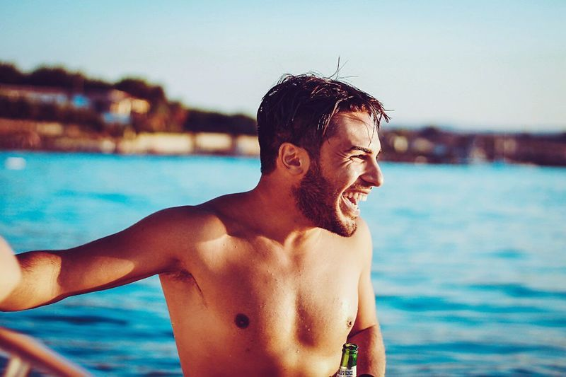 Portrait of smiling young man in swimming pool