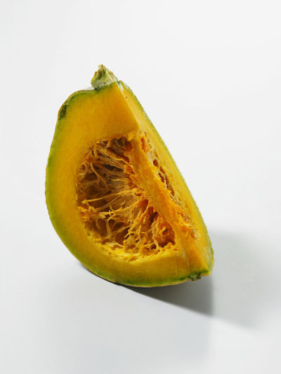 Raw Close-up Copy Space Cross Section Cut Out Food Food And Drink Freshness Fruit Halved Healthy Eating Indoors  No People Pumpkin Raw Food Ripe Seed Single Object SLICE Slices Still Life Studio Shot Wellbeing White Background Yellow