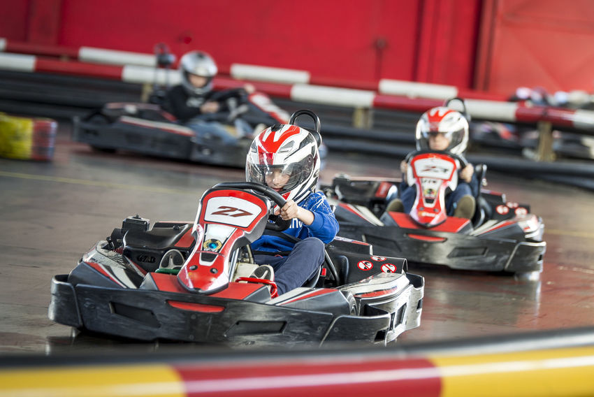 Children Red Auto Racing Competition Competitive Sport Driving Gokart Headwear Helmet Kart Karting Mode Of Transportation Motorsport People Protective Sportswear Racecar Real People Speed Sport Sports Race Transportation