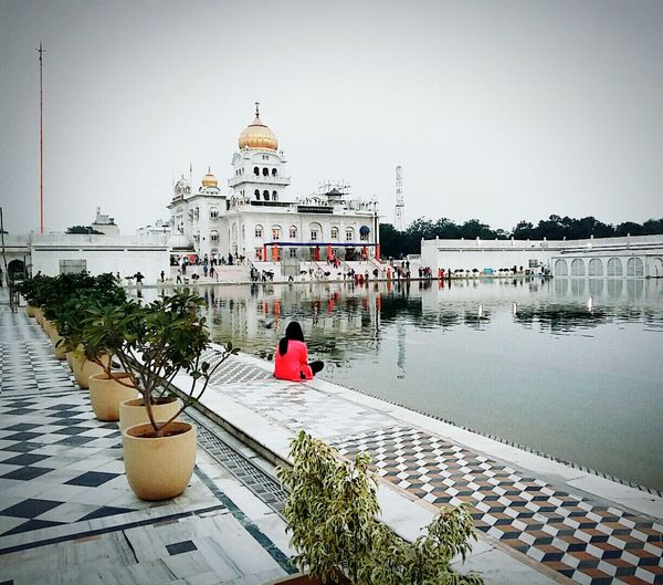 Went for a short trip in the Capital and captured this...Water Clear Sky Lake White Building Exterior Architecture Plants 🌱 Outing Reflections And Shadows Tranquility Calm Girl Gurudwara at BanglaSahibGurudwara New Delhi