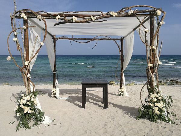 Sea Beach Horizon Over Water Sand Water Day Nature Outdoors No People Sunlight Sky Beauty In Nature Caribbean Riviera Maya Beauty In Nature Weddingday  Wedding Decoration Floral Arrangment Gazebo On The Beach Beach Wedding Gazebo And Nature Sand & Sea Sand Beach Ceremony Nature
