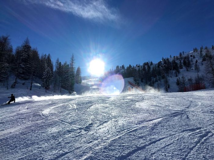 Snow Winter Cold Temperature Lens Flare Sunlight Nature Beauty In Nature Outdoors Weather Tranquility Ski Holiday Sky Day Mountain Landscape Scenics Tranquil Scene Skiing Snowboarding Tree