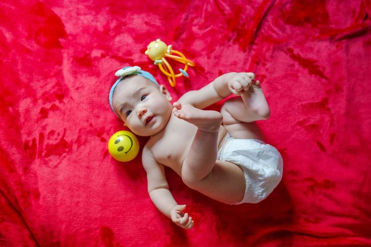 Directly above shot of cute baby lying on bed
